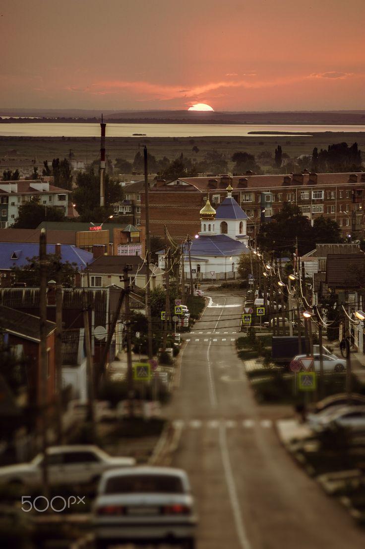 The course of the sunset - Pervomayskaya street, town of Temryuk, Krasnodar Krai, Russia.
