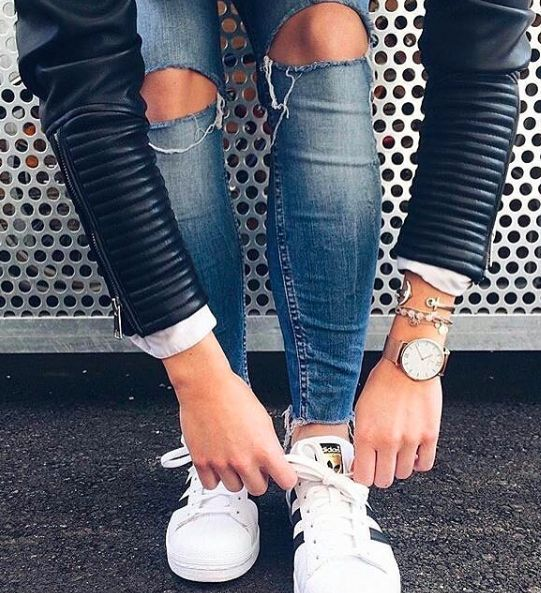 Street style, casual outfit, spring chic, sporty chic, black lather jacket, ripped jeans, white Adidas Superstra