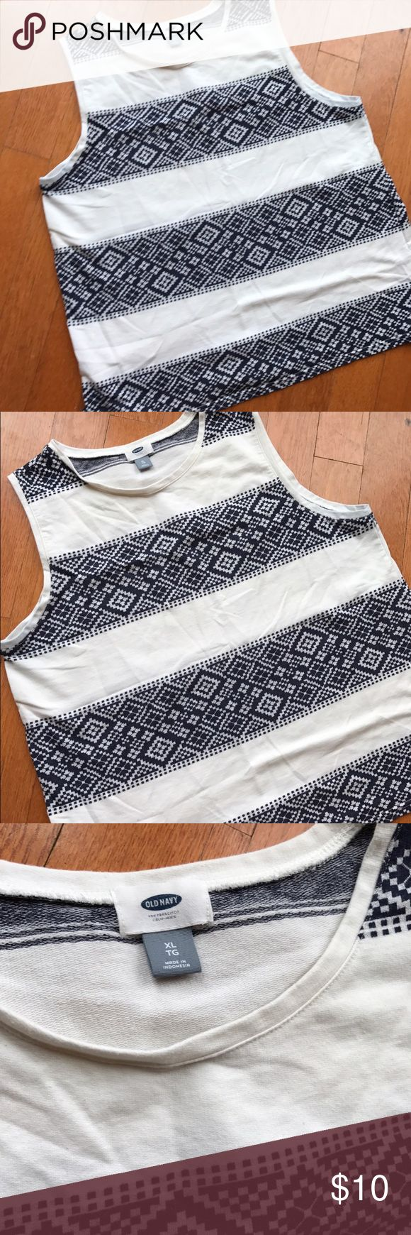 Blue and white print tank Blue and white woven textured print striped with standard white t shirt fabric. Really pretty! Notched sides. Good used condition Old Navy Tops Tank Tops