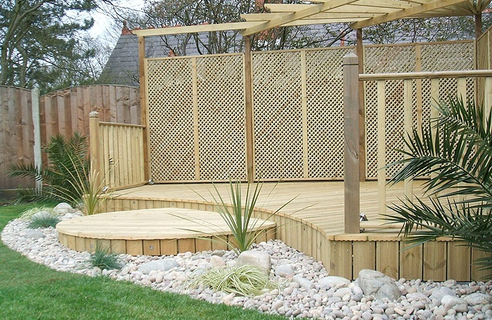 Sheltered decking space which would fit into most gardens for Garden decking ideas pinterest