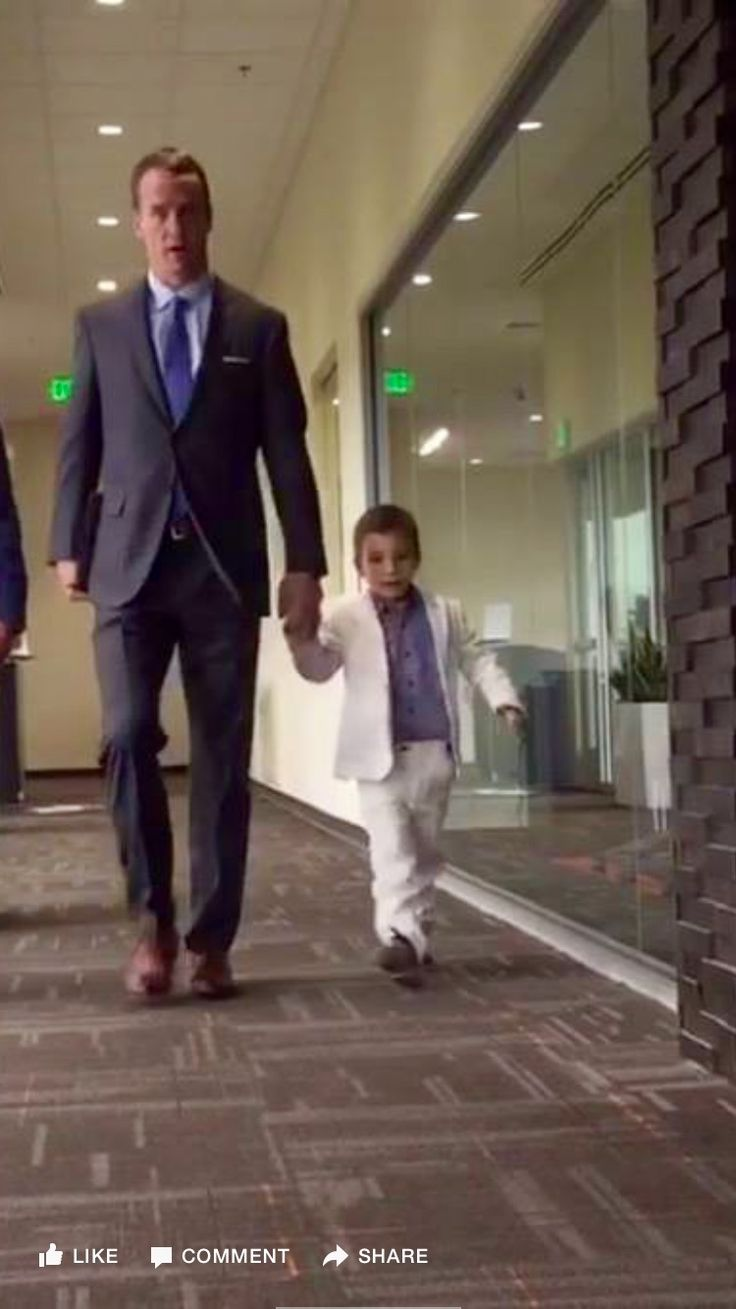 Marshall Manning and his Dad walking to retirement speech.