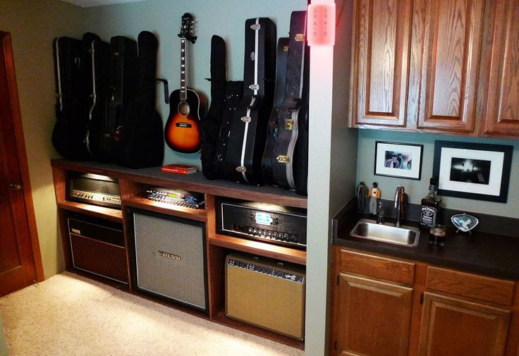 this is what drew needs. he only has two amps. drawers on other side of the center amp for cords, pedals, etc.