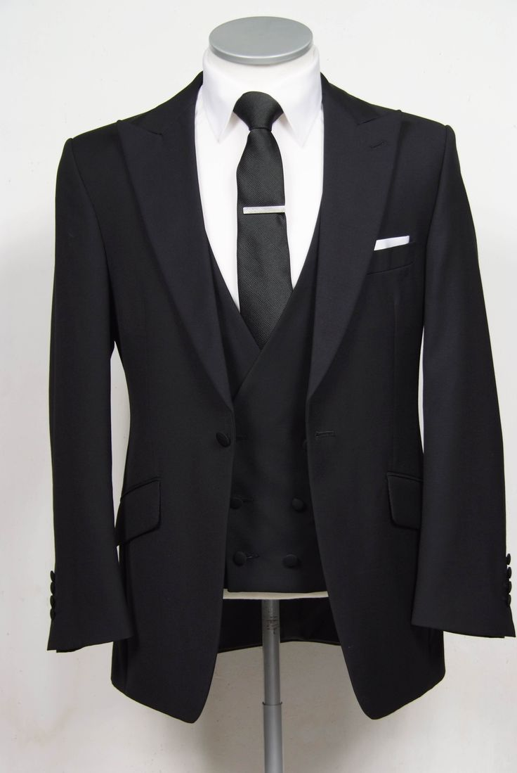 "grooms wedding suit in black slim fit light weight wool with low cut double breasted waistcoat. Mens sizes from 32"" chest upward and include extra short, short, regular, long and extra long fittings. Boys sizes from 20"" to 34"" chest. Complete outfit includes jacket, skinny trousers, hire or matching waistcoat, brand new traditional or French wing slim fit shirt in white or ivory, tie or cravat, braces and cufflinks. £150.00 to hire #groom #wedding #suit #hire #suithire  #waistcoat #black"