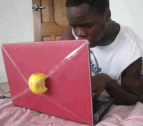 The apple laptop...boy is that REAL apple going brown...