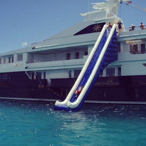 He has a million-dollar yacht ⛵ but all the fun is an inflatable slide