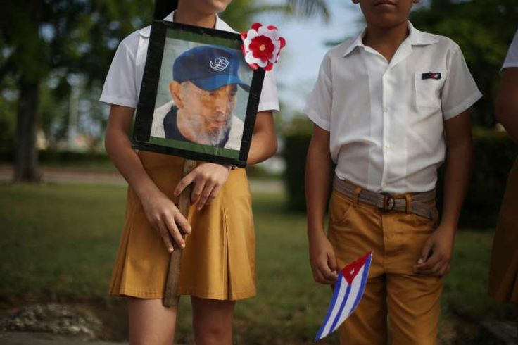 Fidel Castro's ashes travel across Cuba:   Children await the arrival of the caravan carrying the ashes of Fidel Castro in Guaimaro, Cuba.