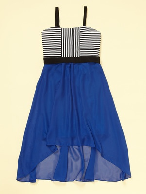 A Sally Miller Horizontal and vertical striped top half of the dress and a blue bottom of the dress, shorter in the front and longer in the back with black straps.