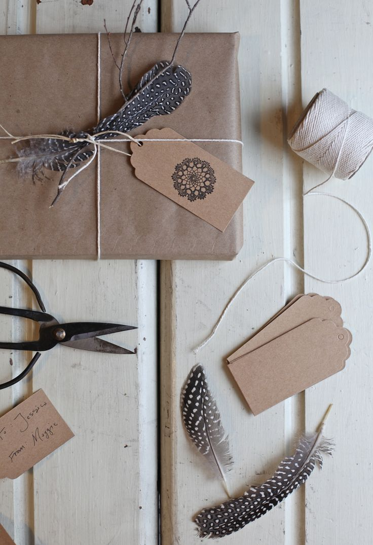kraft gift wrapping with feathers by Maggie Pate//