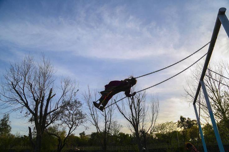 The girl on the swing. In today's Dawn newspaper  #childhood #fun by sarafarid