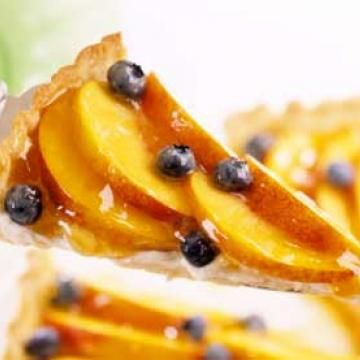 Nectarine Tart    The filling in this low-fat dessert tastes deceivingly rich. Fat-free cream cheese is the key. For a pretty finish, arrange the nectarines or peaches and blueberries in a pinwheel design before glazing with the apricot spread.    Calories: 140 calories per slice  Carbs: 23 g per slice