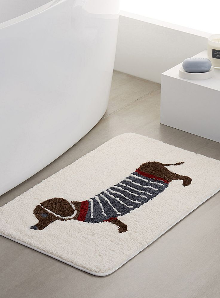 - Add a fun touch to the bathroom with this pattern of sausage dogs dressed in a striped sweater on an ivory background - Ultra soft and smooth polyester microfibre - Non-skid backing - Easy-care, machine wash and dry