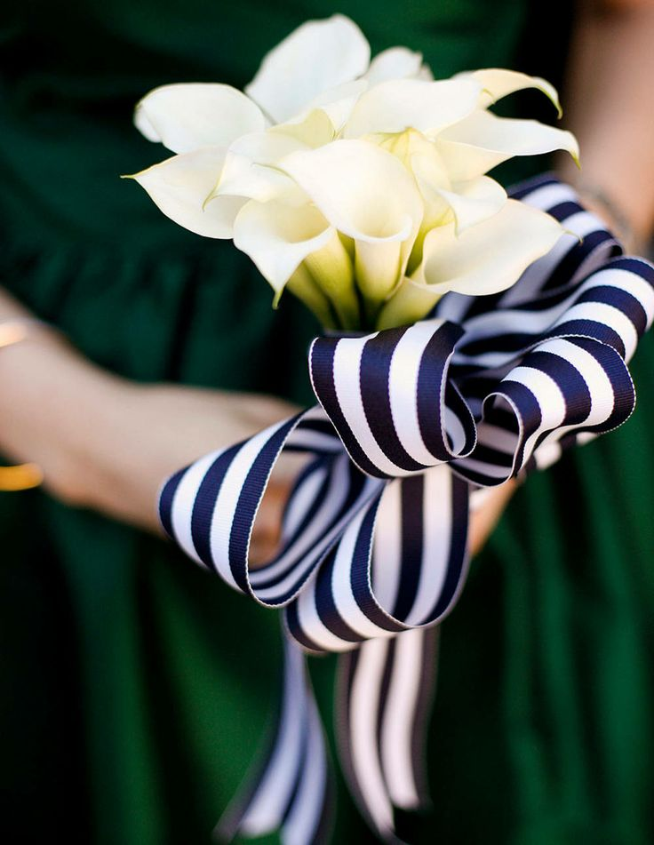 Navy and white striped ribbons secured the bridesmaid bouquets. Photograph by Belathée Photography.