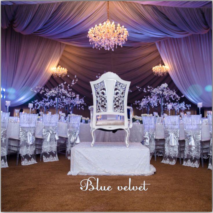 All white decor at blue velvet marquee