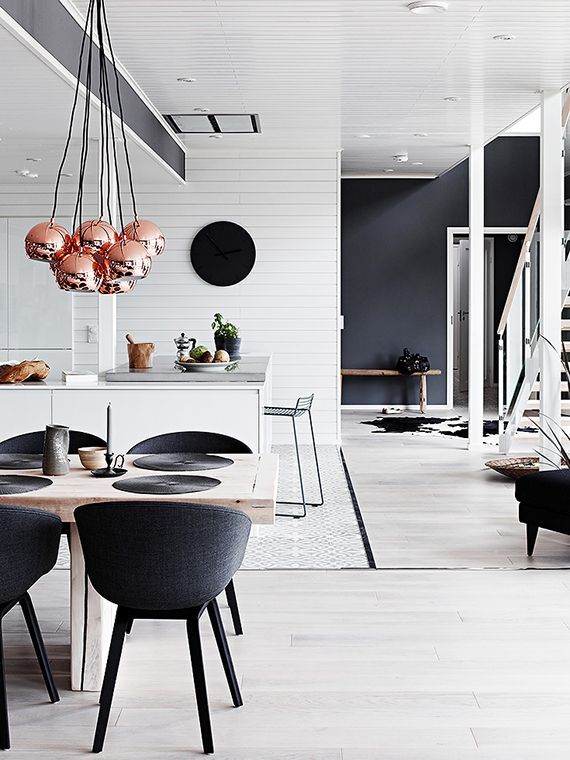 We love the different textures used in this Black And White Kitchen, Dining and Living - ELLEDecor.com