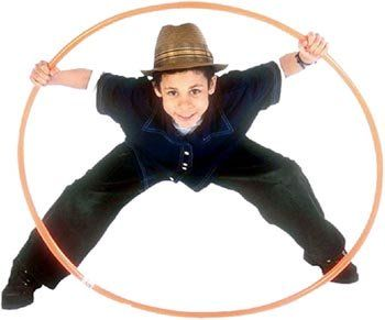 Unconditional parenting is showing unconditional love and not about making your child jump through hoops for your love. Picture of boy looking through a hula hoop ring.