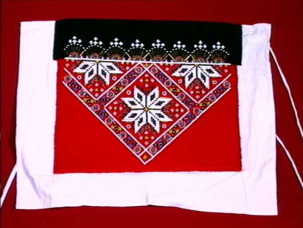 A Norwegian beaded bringeklut (breast piece for a bunad). for a Hardanger bunad