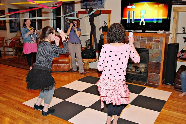checkered dance floor with Wii dance game