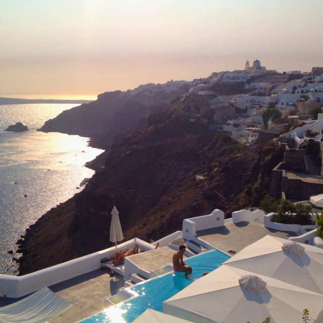 Kirini Suites & Spa. Hotel and restaurant on the seafront. Greece, Santorini. Unique in the world: the White Cave Restaurant sculpted into the rocks by the pool.