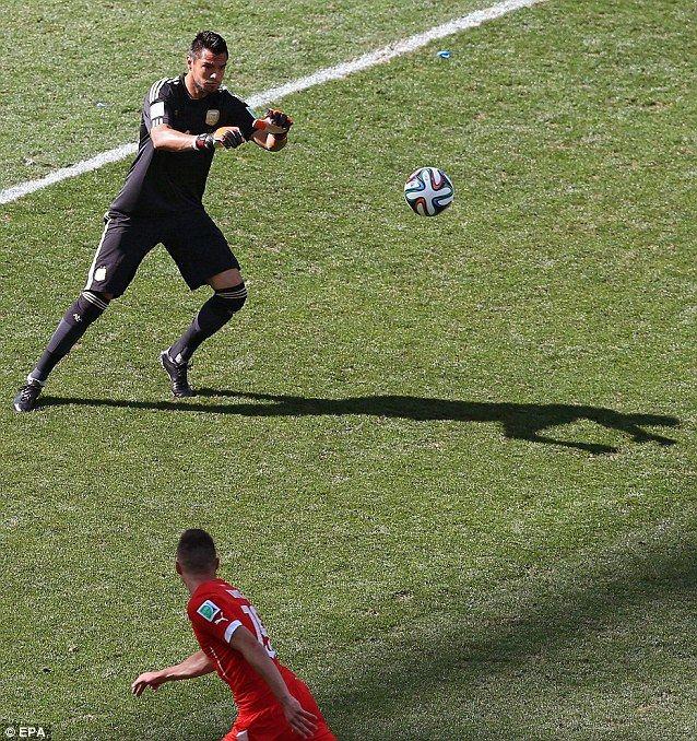 Tame: Argentina goalkeeper Sergio Romero saves the attempt of Josip Drmic...