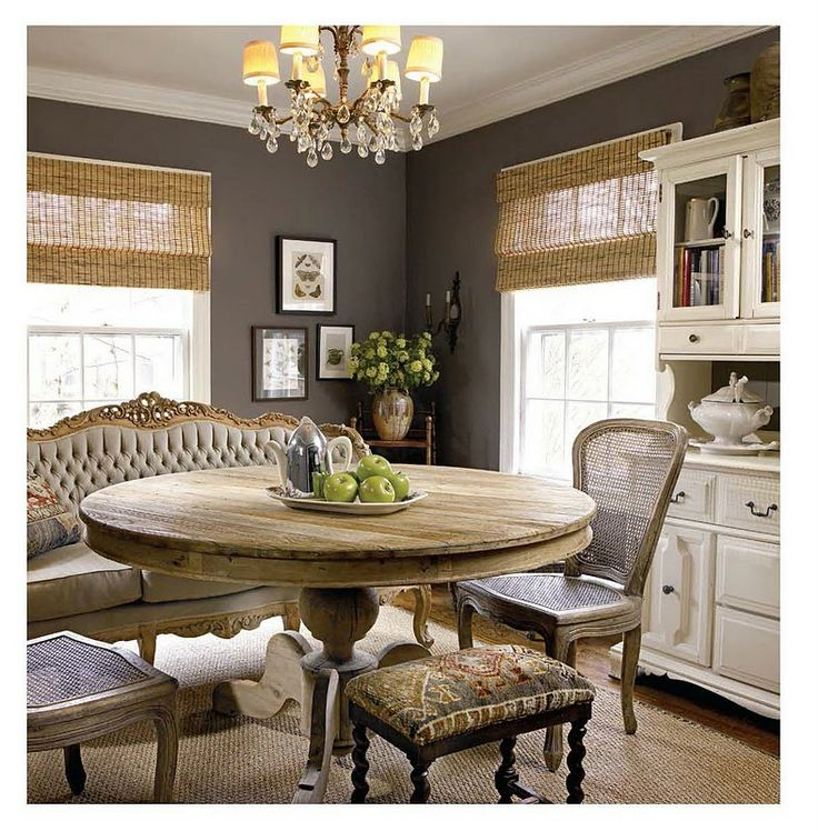 dark gray walls, seating mix, rustic round table