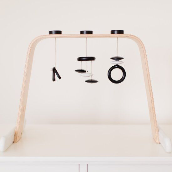 Make a beautiful, minimalist wooden play gym using the Ikea Leka.