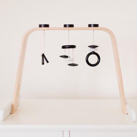 Make a beautiful, minimalist wooden play gym using the Ikea Leka.