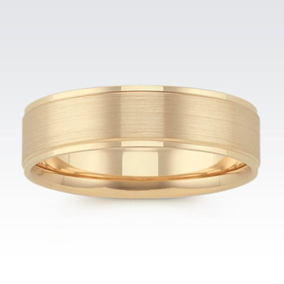 His attire will always be finished with a sophisticated elegance when he wears this classic comfort fit band crafted of 14 karat yellow gold. The 6mm band is handsomely accented by a satin finish around the center of the design while polished finishes provides a crisp outline.