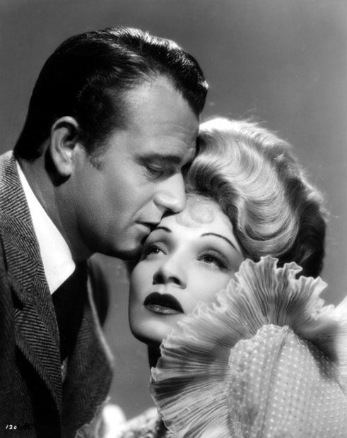 - john wayne & marlene dietrich - Had a fling. That is the expression of a man besotted!