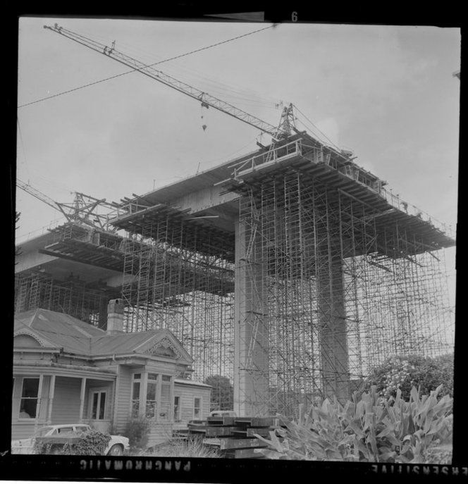 Construction of southern motorway viaduct from Clovernook Road, Newmarket, Auckland, including house used as site office
