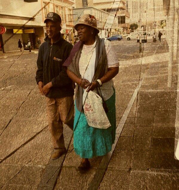 Old couple. Johannesburg city street scene.
