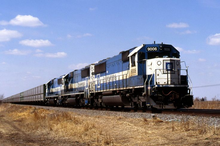 https://flic.kr/p/Pk2keG | A Look Back | Three Oakway SD60s had Burlington Northern's oddball Trough Train eastbound on the Ottumwa Subdivision in 1996. It was a neat looking and sounding train when hitting joints at track speed; quite an interesting rhythm. Check it out...  www.rail-videos.net/video/view.php?id=625  (Not my video...) But of course it's all gone now.