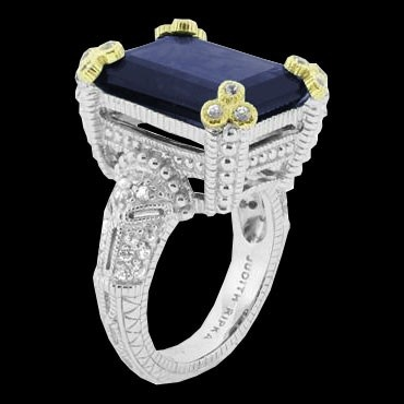 This Estate collection Judith Ripka ring features a large emerald cut Blue Corundum with white sapphires in sterling silver and gold accents.
