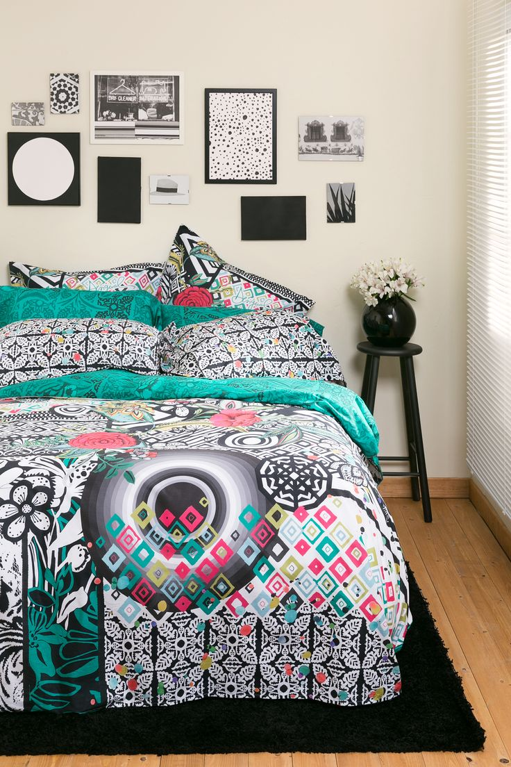 This colorful printed bedding, punctuated with black detailing will brighten up any room!