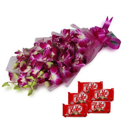 Bunch of 6 Purple Orchids in cellophane wrapping with pink ribbon bow and 5 Nestle #Kit #Kat #Chocolate. http://www.fnp.com/flowers/orchids-with-chocolates/--clI_2-cI_1123-pI_23668-i_23311.html
