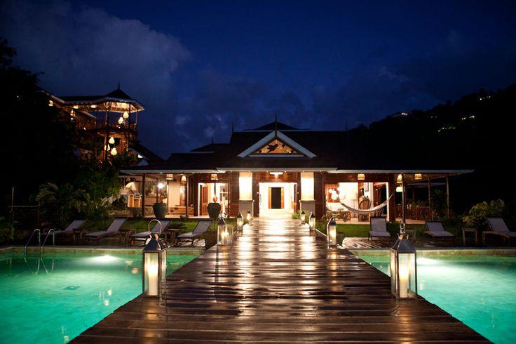 A stunning villa in the caribbean by Nomade Architettura. A timber bridge over the pool to conduct to the gazebo. #nomadearchitettura #design #interiors #interiordesign #luxury #decor #luxurylife #caribbean #villas #woodenbridge #pool