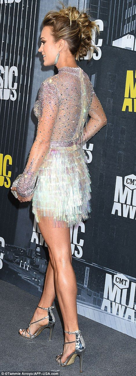 Good looking:The singer highlighted her sculpted legs in a silver sequined top with a textured mini