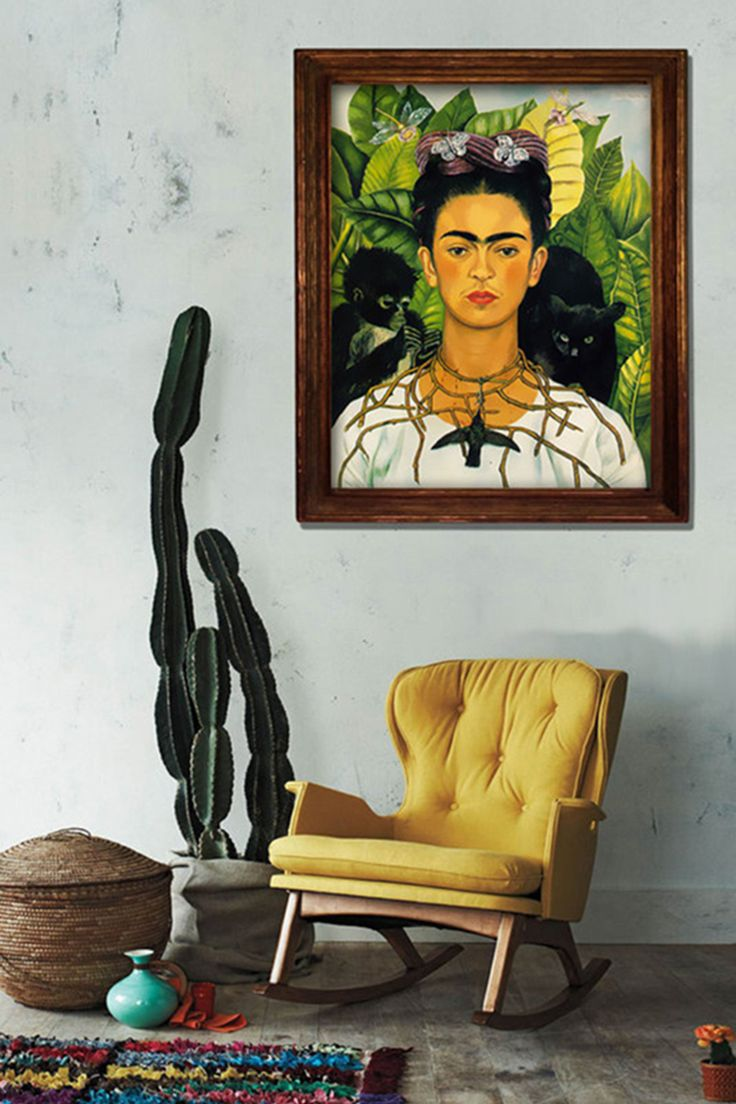 A big wooden frame is a great choice for your Frida Kahlo art. Together with a cactus, woven basket and colourful carpet, it will give your room a Mexican vibe. A bright chair (like this vintage one) is a smart choice too.
