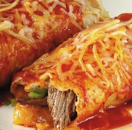Baked Steak Burritos....I used tomato sauce mixed with fajita seasoning and hot sauce instead of enchilada sauce. Filled burrito with rice, corn, steak, sauce, cheddar cheese, then topped with remaining sauce and Mexican cheese. Baked as directed then broiled for 3 minutes on high. Kids loved!!
