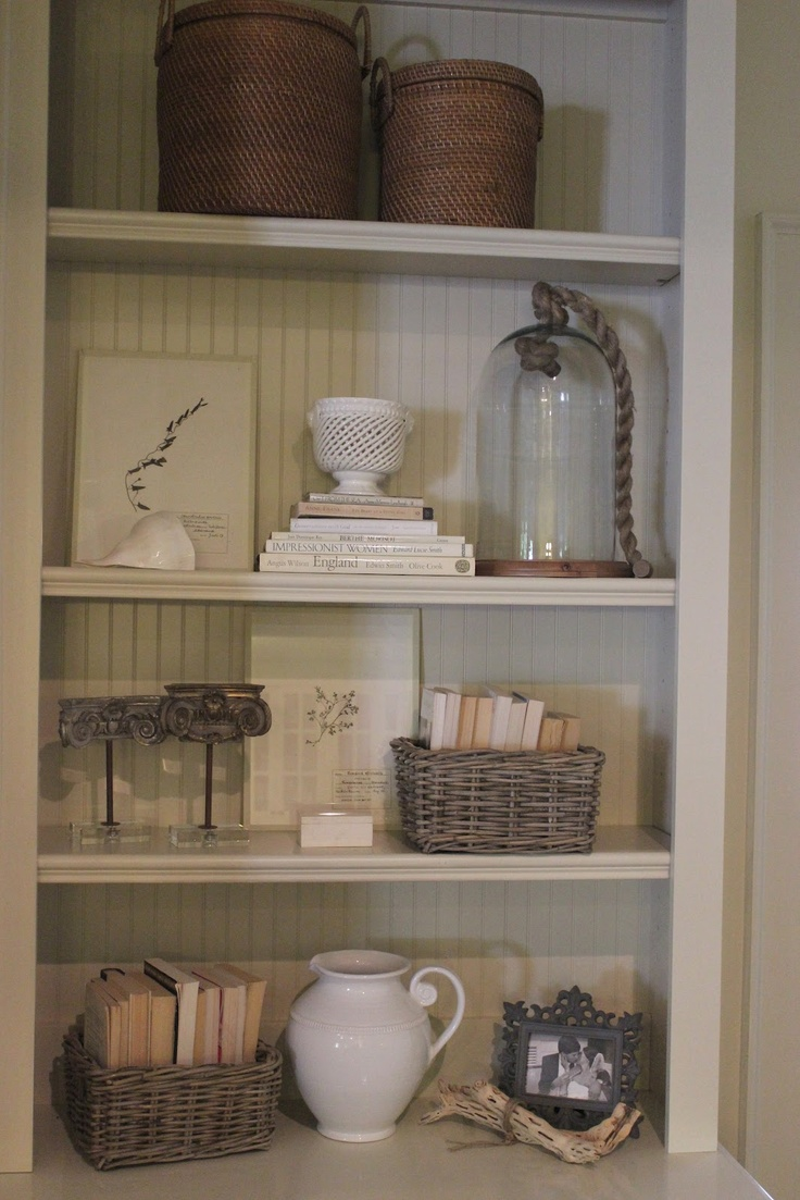 neutral shelves - Love the storage baskets on the top and the white picture on the bottom. I like the idea of storing paperbacks in baskets.