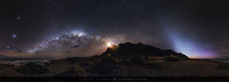 Cape Palliser by Night - Cape Palliser on the North Island of New Zealand is one incredible place to view the night sky. The only light in this remote and rugged location is the Cape Palliser lighthouse perched high above the coastline.  This image is a seamless 360 degrees panorama features our Milky Way galaxy, the Small Magellanic Cloud, the Large Magellanic Cloud and the Zodiacal Light which extends up from the horizon in the right side of the image.   Keep up to date with my latest…