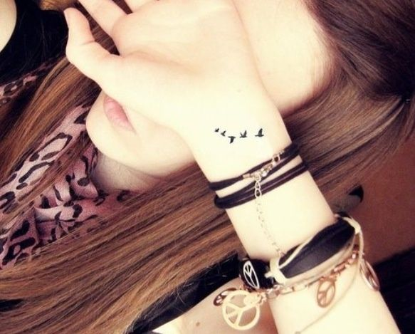 tiny bird wrist tattoo