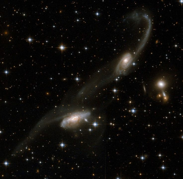 ESO 69-6 (also known as ESO 069-IG006 and AM 1633-682) consists of two interacting galaxies about 650 million light-years away in the constellation of Triangulum Australe. The two galaxies are moving away from us at a speed of almost 14,000 kilometers per second.