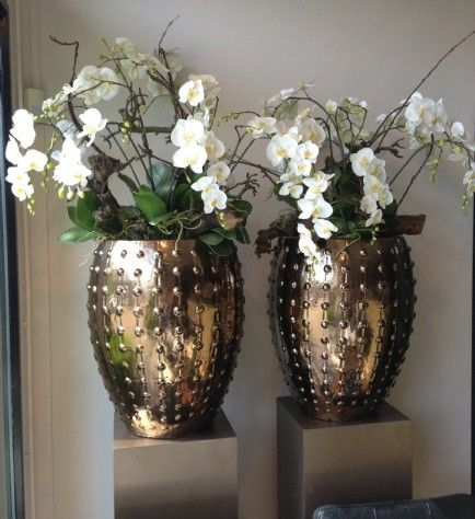 Gold vase with beautiful flowers home decoration