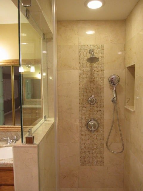 17 best ideas about vertical shower tile on pinterest large tile shower bathroom tile designs for Best paint color for crema marfil bathroom