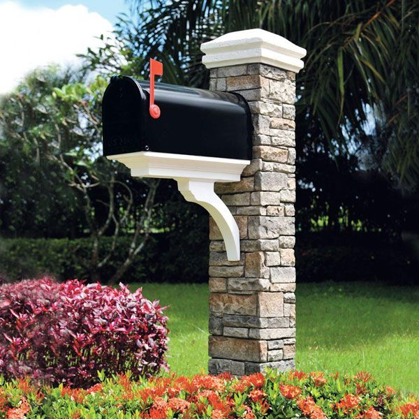 Gray stacked stone brace and curved cap mailbox post for Punch home and landscape design won t install