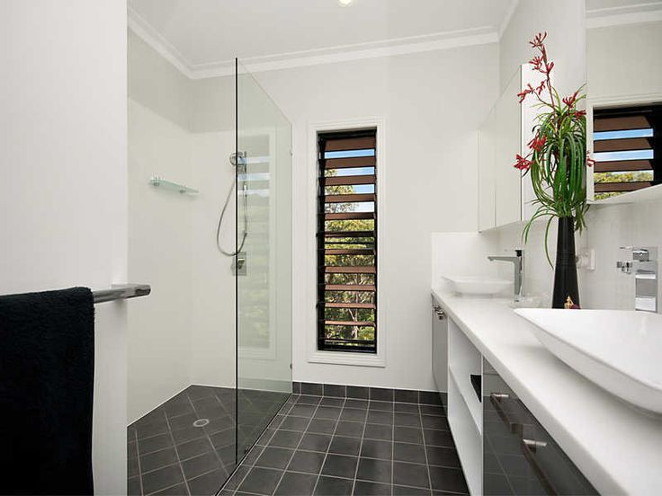 bathroom ideas with frameless glass, timber, floor-to-ceiling windows and louvre windows