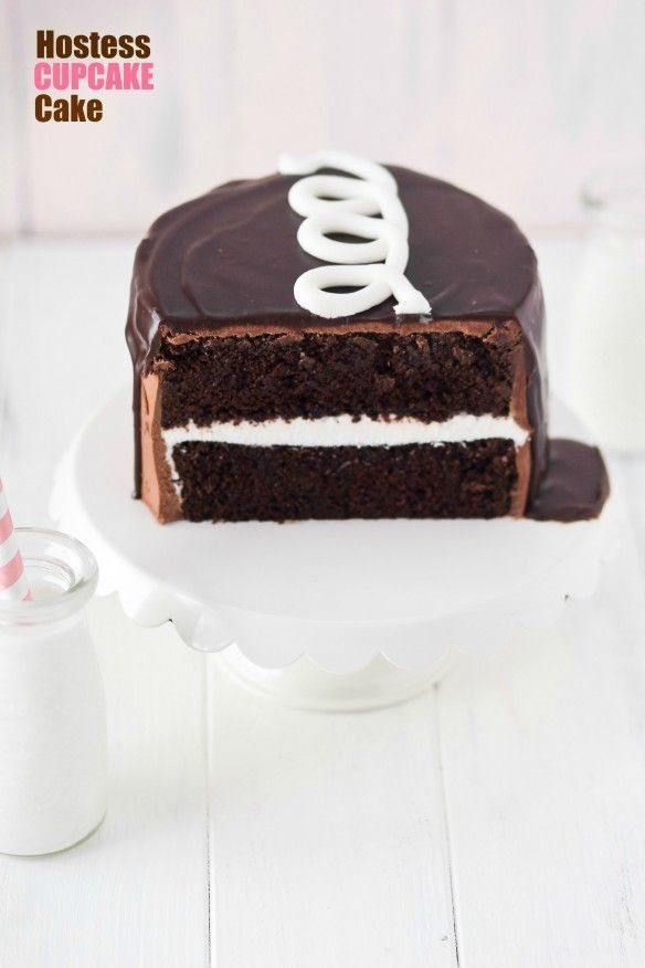 Hostess Cupcake Cake recipe.  Hostess Cupcake fans will LOVE this Hostess Cupcake Cake filled with cream filling and topped with a signature squiggle!
