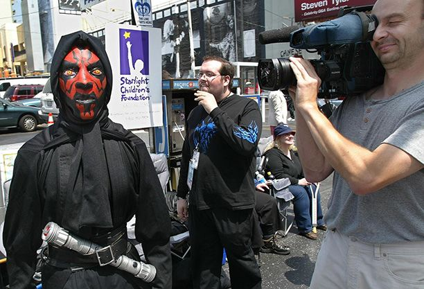 April 11, 2002: An actor dressed as Darth Maul welcomes fans ahead of the 'Attack of the Clones' premiere at Hollywood's Mann's Chinese Theater