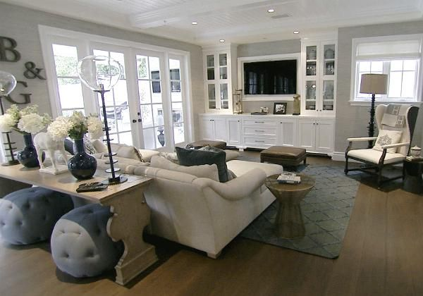 Giuliana Rancic's home, sophisisticated and neutral. Love the built-in for the TV.