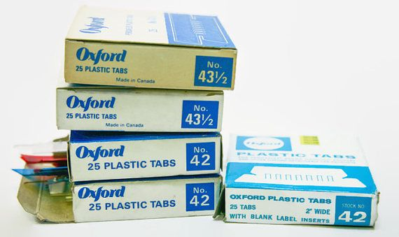 5 boxes of 25 Oxford Pendaflex Plastic Tabs. Made for Oxford Pendaflex Canada Ltd, this lot contains 2 boxes of No. 43 1/2 clear tabs, one box of No. 42 clear tabs and one box of No. 42 red, blue and clear tabs.  The plastic has aged and yellowed accordingly, so the clear is more a yellow hue, but all are in perfect, new-in-package condition.  ***** Please note items are being shipped via ground shipping with Canada Post. Tracking and insurance is not included in this standard shipping r...